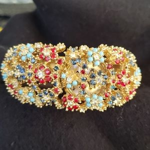 VTG Norman gold color multi stone hinge watch